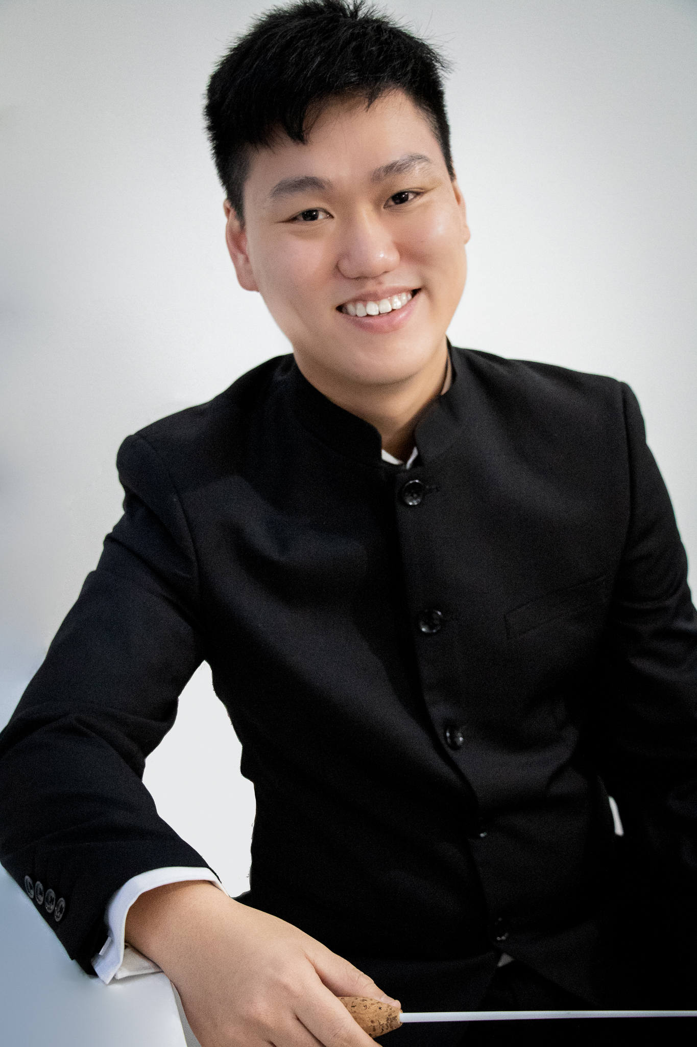 Headshot of conductor Melvin Tay